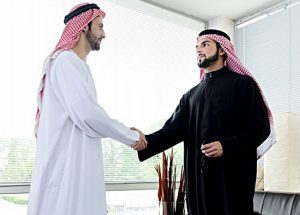 Successful-Arabic-business-people-shaking-hands-over-a-deal